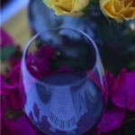 Red wine and yellow roses with bougainvillea