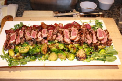 Grilled Steaks with Brussels Sprouts and Balsamic Red Onions